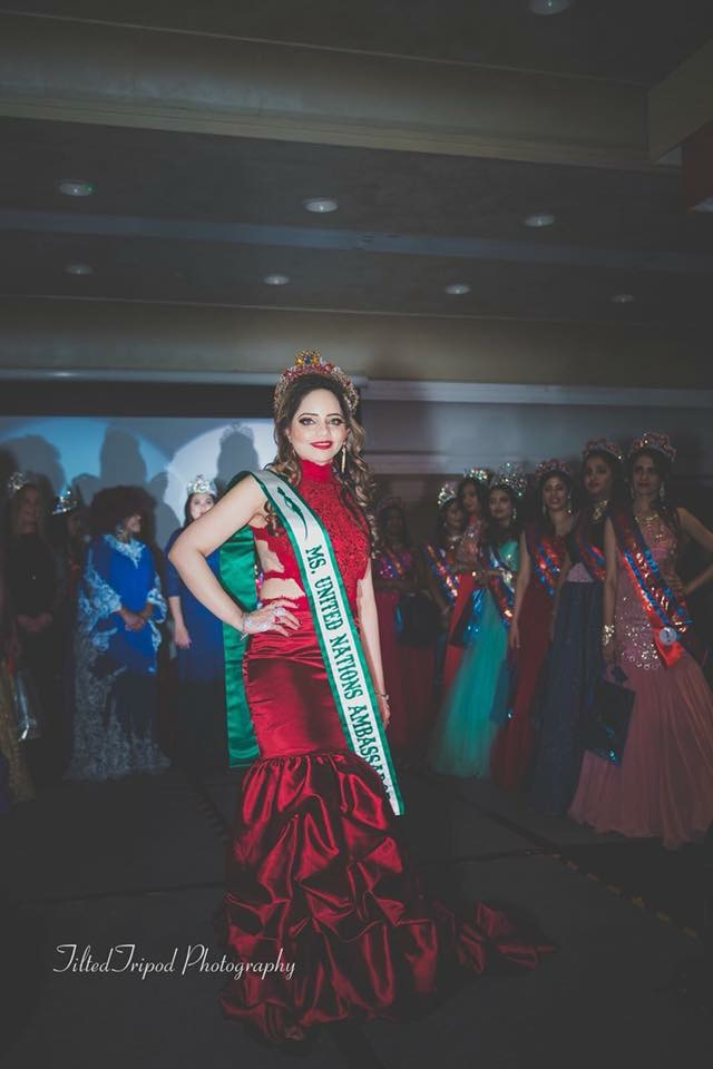 Rachanaa Jain with a misleading sash that says United Nations Ambassador